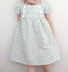 Junebug Dress for little girls.  This is SUCH a cute dress!  The simple lines show off a favorite fab…