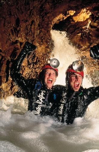 Black water rafting in Waitomo caves. must do!