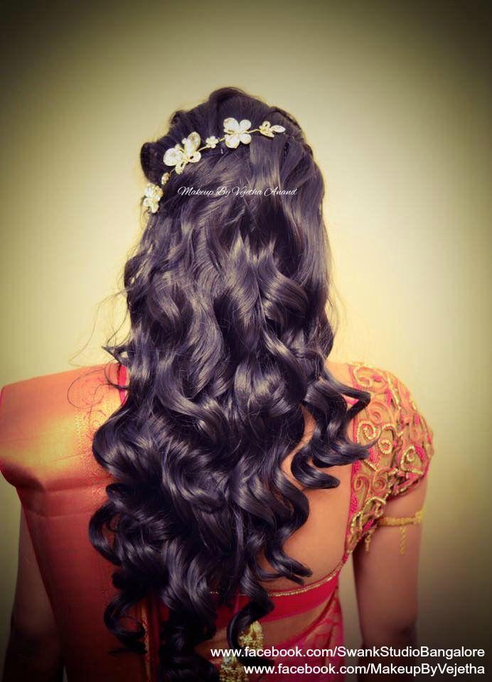 Indian bride's reception hairstyle by Vejetha for Swank Studio. Curls. Bridal hair. Saree Blouse Design. Hair Accessories. Tamil bride. Telugu bride. Kannada bride. Hindu bride. Malayalee bride. Find us at https://www.facebook.com/SwankStudioBangalore