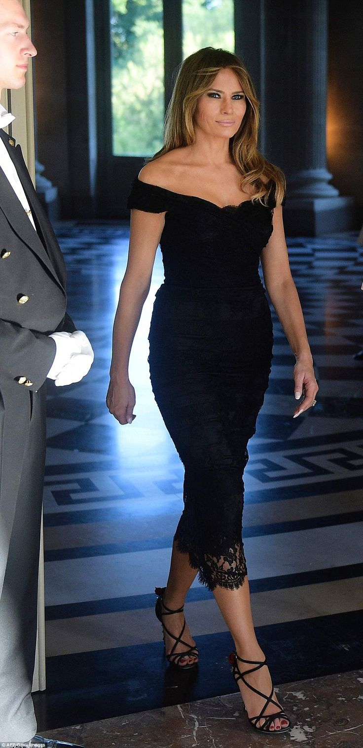 Melania Trump changed into an off-the-shoulder, black lace gown to meet Queen Mathilde of Belgium at the Royal Castle of Laeken on Thursday evening after spending the afternoon at the Magritte Museum in Brussels with other NATO spouses