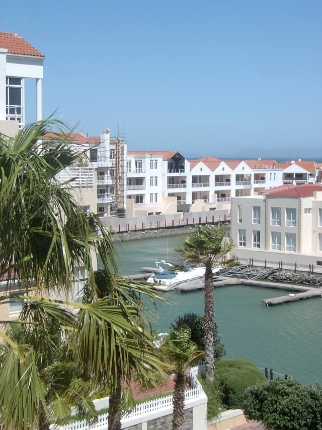 This spacious apartment boasts the best of all worlds. It has beautiful views of the mountains & sea on one side & views of the marina & pool on the other. The kitchen has granite tops and the airconditioned lounge & dining room is also very spacious.