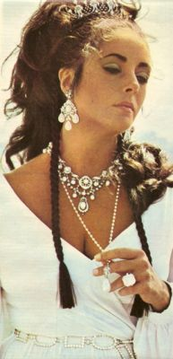 Liz Taylor in some of her signature jewels going up for auction in December. Who wants to buy me a Christmas present?