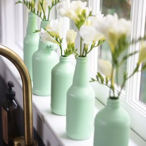 These gorgeous and simple vases are perfect for a wedding or bridal shower. Use old bottles to make good-as-new decorations. I love the mint color - so trendy!