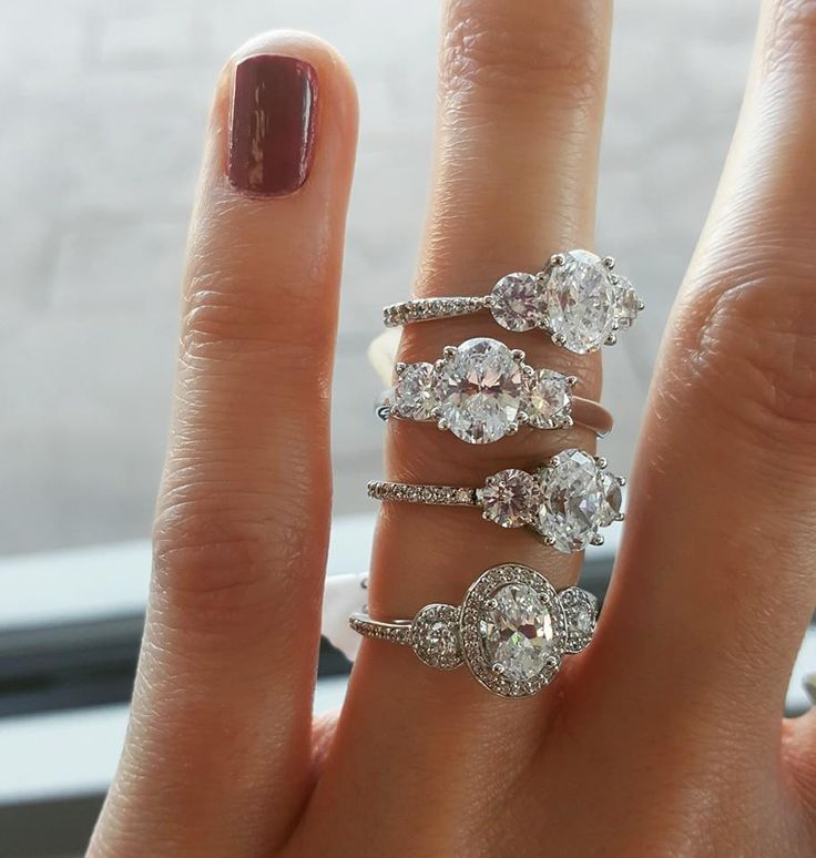 Three Stone Oval Engagement ring designs!!! Oh my word, the first one!! But maybe without the additional stones on the band :)