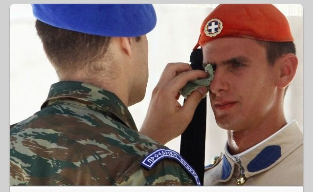 """""""A soldier wipes the face of a Presidential Guard (who is not allowed to move as long as he is on duty) in front of the Greek Parliament as temperatures reach 44 degrees Celsius (111F) in Athens."""" Be NICE to people. The UNIVERSE will reward you in time."""