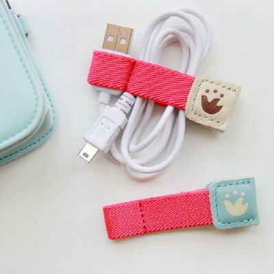 DIY Tutorial - keep your cords organized by making a cord holder out of elastic tape, so simple!