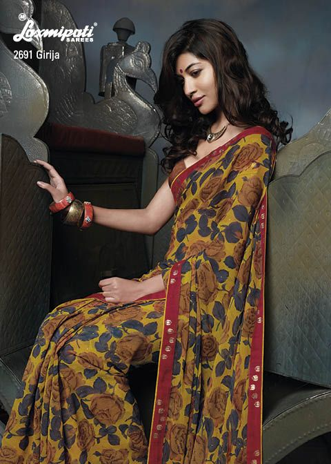 This Mustard & Brown Colored chiffon material saree with red border