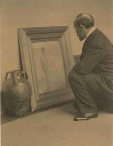 "1899: At the age of forty-five, Freer retires from active business to devote himself to collecting art. This photo shows how Freer juxtaposed a painting by American artist James McNeill Whistler with a ceramic piece from the Islamic world, comparing the jar's glaze with Whistler's color harmonies.   Freer comparing Whistler's ""Venus Rising from the Sea"" (F1903.174) to an Islamic glazed ceramic pot (F1905.61); photograph by Alvin Langdon Coburn (American, 1882–1966); 1909; Charles Lang Freer…"