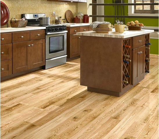 Is rustic your style this kitchen has greens and browns for Rustic red oak flooring