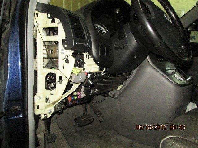 2007 Hyundai Entourage/Kia Sedona with lower dash cover removed to gain access to air temp control motor