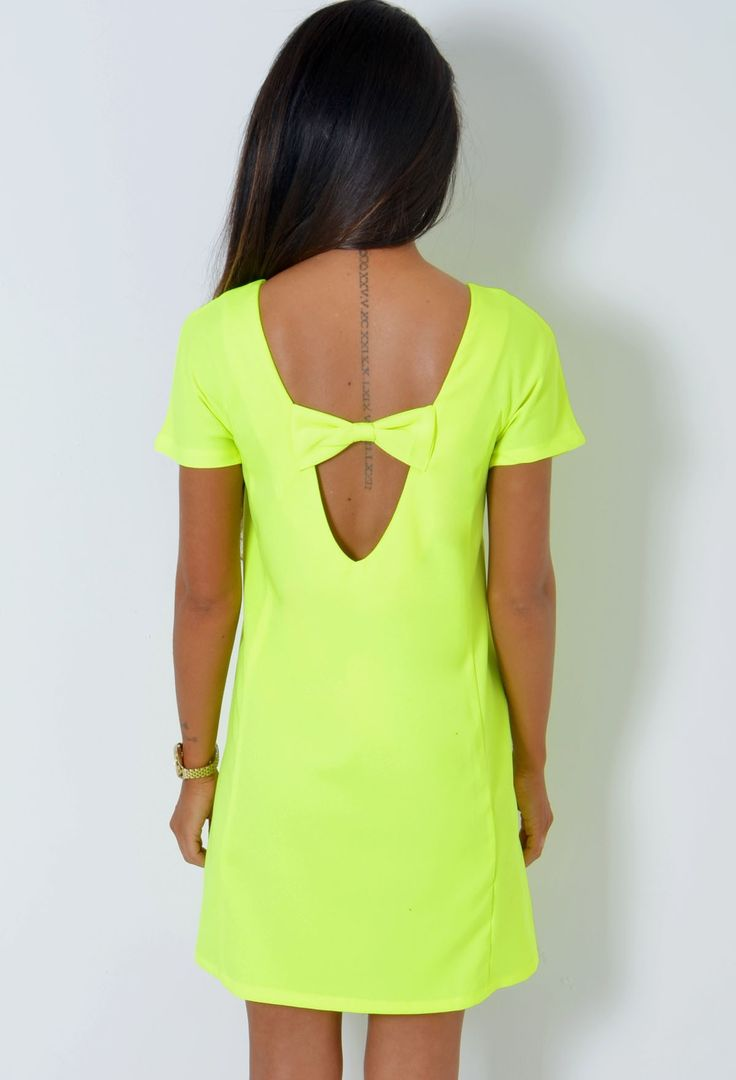 http://www.pinkboutique.co.uk/tenishia-neon-yellow-cut-out-bow-back-tunic-dress.html