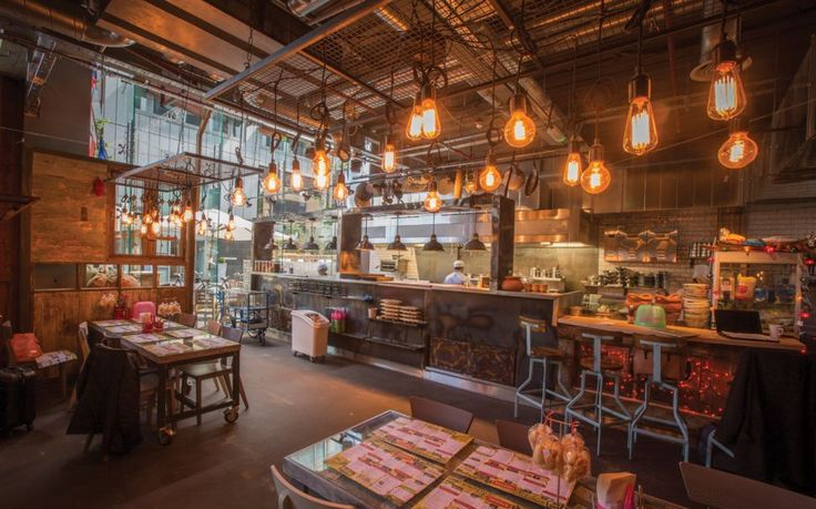 Bare lamps for Thaikhun Thai restaurant in Manchester. It features various types of Edison lamps suspended from the rusty mesh steel box by black braided cables. Interior Design: JMDA