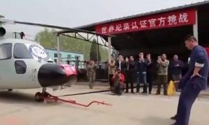Kung Fu expert breaks World Record for hauling Helicopter with his manhood (Photos)