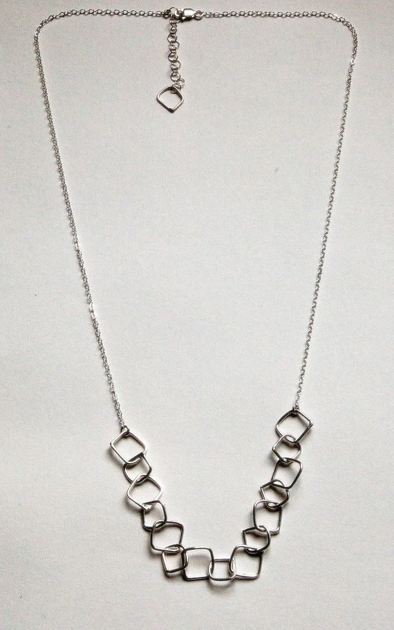 Abstract Square Chain Link Necklace in Sterling Silver:    I fabricated the abstract links one at a time by hand and soldered these together. Once complete