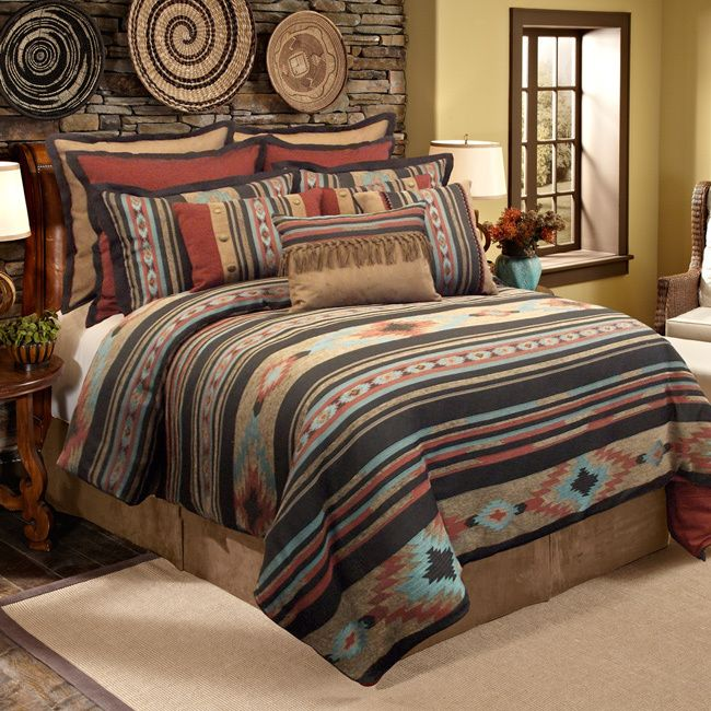The quality Veratex Santa Fe comforter set is constructed from smooth polyester and soft cotton backing. The comforter along with matching shams and bedskirt feature a tribal print in stunning earth tonal colors.