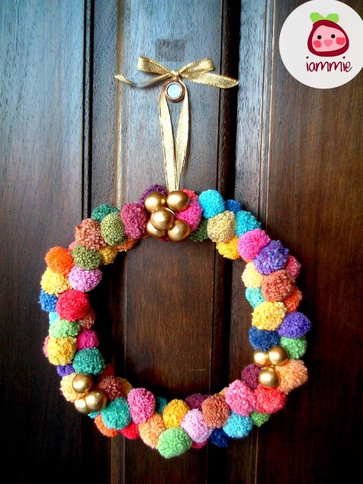 Pom Pom Wreath, party pom pom, yarn pom pom, garland, cotton, colorful, decoration, door, wall, pompom, decoration. $30.00, via Etsy.