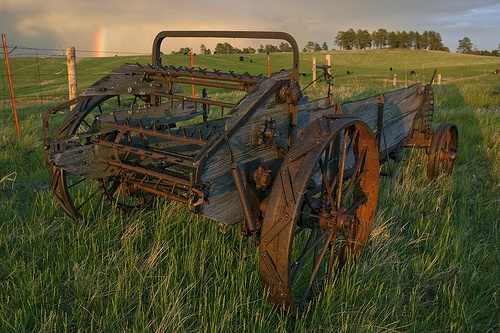 """Horse drawn manure spreader Old farm equipment. I remember the one my grandfather had.  He pulled it with his """"tricycle"""" style Farmall."""