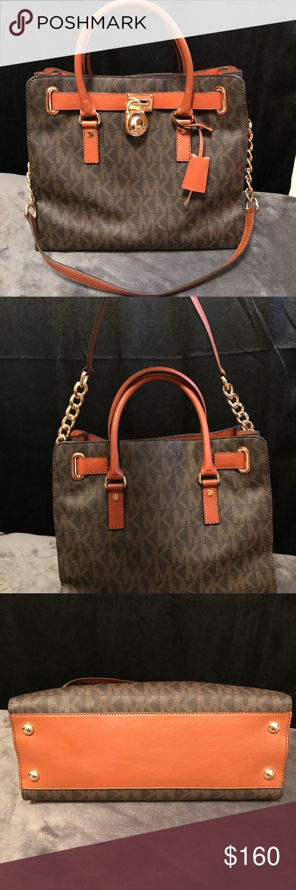 """Michael Kors Large Brown Hamilton Satchel • 100% Authentic Brown Signature Hamilton  • Gold-tone hardware w/Lock & Key on front • PVC Leather w/magnetic snap closure  • 4 signature metal feet on bottom for protection  • Fully Lined interior w/signature fabric, 1 zip slip pocket, 1 Cellphone pocket w/3 slip pockets & key clip  • Measurements 14""""L x 12""""H x 5-1/2""""D • Double-roll handles w/4-1/2"""" drop & 12"""" drop shoulder strap, comes with dust bag  • NO RIPS/TEARS/STAINS. (EUC) Michael Kors Bags…"""