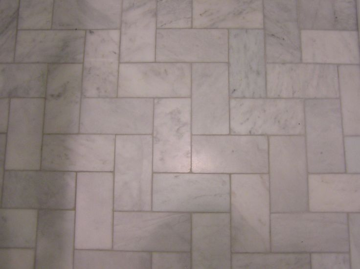 The Bathroom Floor Is Marble Subway Tile Installed In A