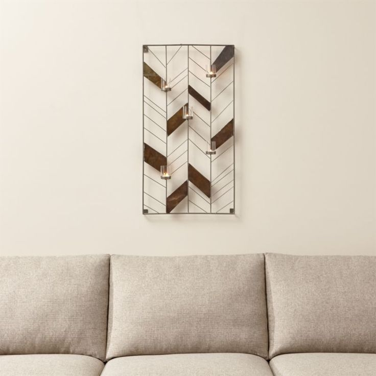Brass, crumpled and given a warm antique finish, randomly fill a clean, chevron grid of silvery iron, creating a dynamic composition of…