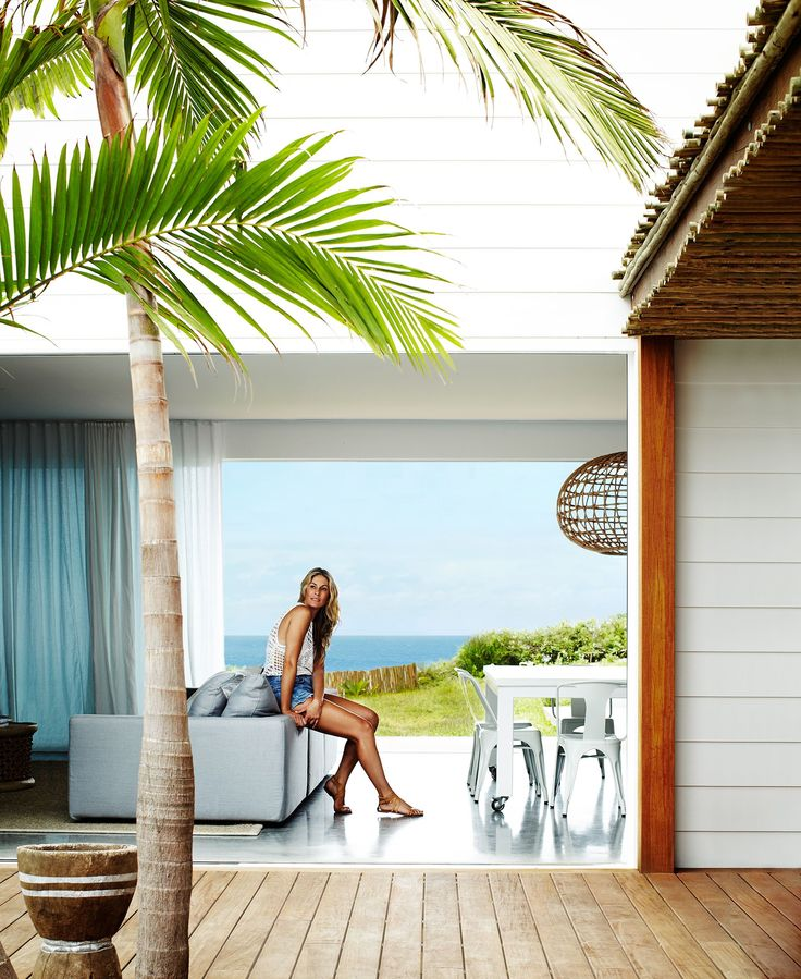 """""""We wanted to create a living space that opens to both the internal courtyard and to the ocean views,"""" says the home's architect Eduardo Villa. A polished concrete floor has underfloor heating, which in cooler months warms the entire house. A Bangalow palm is a new addition to the courtyard."""