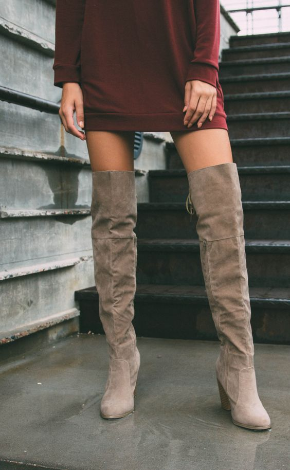 All eyes will be locked on you when you walk by in the Locklyn Suede Knee High Boots in taupe! Featuring a faux suede in an over-the-knee styling. Partial side-zip closure and lace-up corset detail at