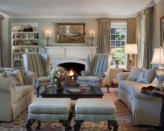 Lovely cozy size living room with wing chairs, overstuffed sofas ...