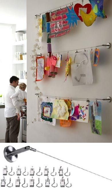 Choose an empty wall in your home or child's bedroom to install this versatile clip and cable system by Ikea.   This allows kids to hang their own artwork and interchange new and old projects as they please.   Image Source: Ikea Cable System