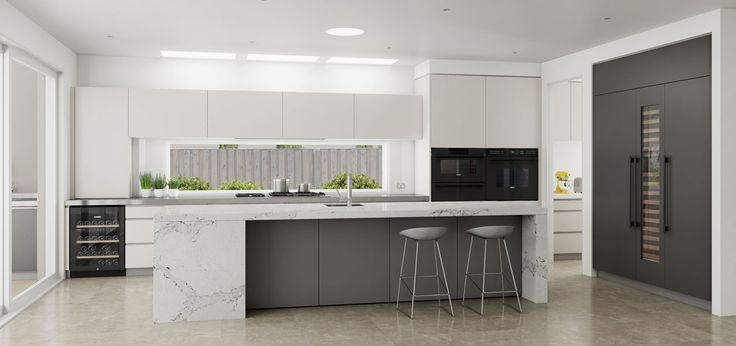 Ultra modern kitchen in grey tones. Large Wolf E-Series ovens. Freshwater, NSW #DanKitchensAus