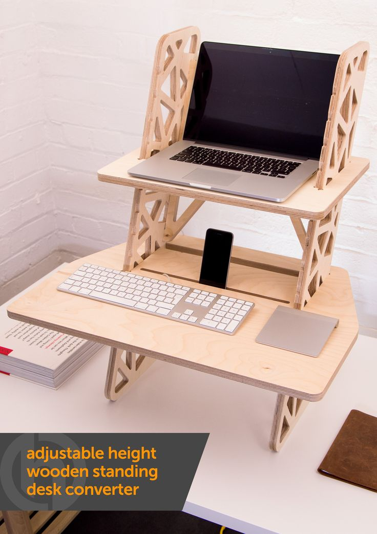 "Adjustable height wooden standing desk converter. This ergonomic standing desk sits on top of your existing desk or table and suits anyone from 5'1"" to 6'2"". No screws, bolts or little allen keys required. Made from sustainable European Birch plywood - designed and made in the UK by Helmm. £235 with free UK delivery from www.helmm.co"