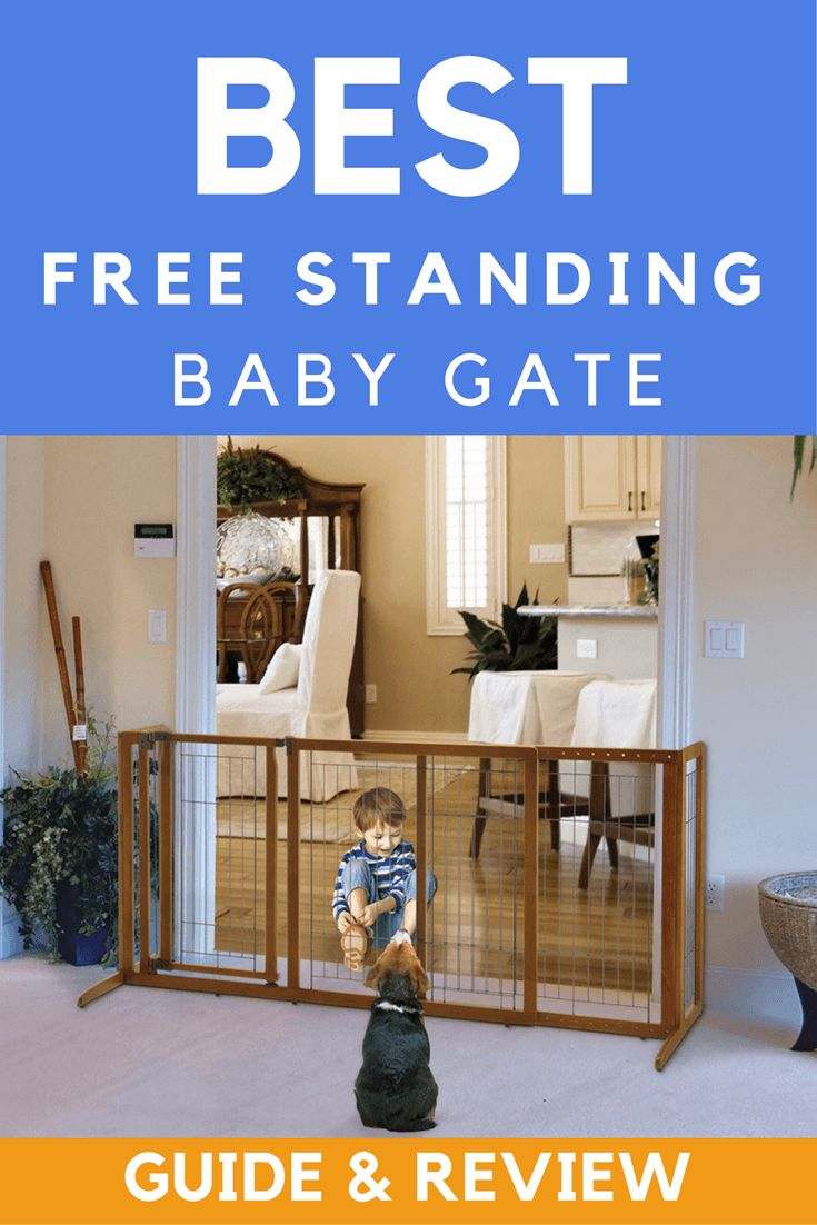 This gate clearly stands on its own 2 feet! It needs no help because it is free standing and not afraid of wide open spaces!