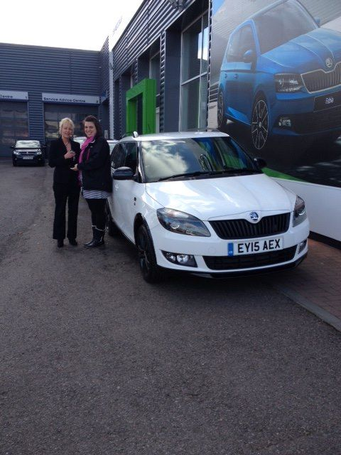 Another happy handover of a new #15Plate ŠKODA Fabia Estate to Emily Bell in front of a poster of its little hatchback brother!