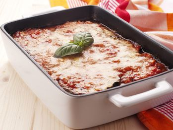 eggplant-parmigiana-deluxe - add sausage or ground beef for extra protein. Roasting the eggplant in the oven instead of frying is a lot easier