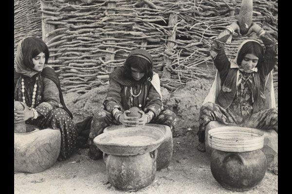 Three young women of Kurdistan mashing food, Iraq. WHO/Edouard Boubat
