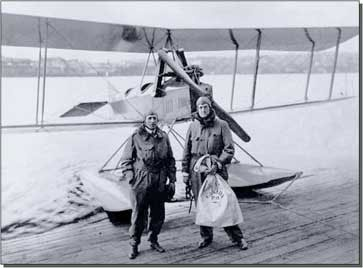 Bill Boeing [on the right], with the Canadian postal sack containing sixty letters written by people in Vancouver to people in Seattle