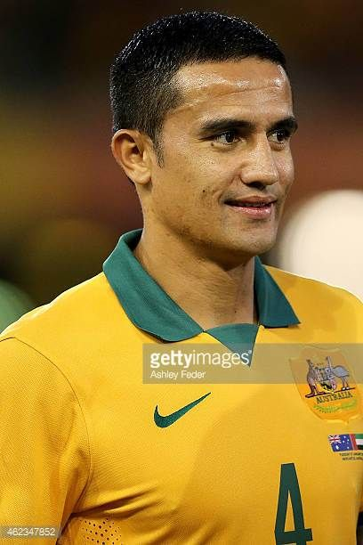 Tim Cahill of the Socceroos watches on during the United Arab Emirates National Anthem during the Asian Cup Semi Final match between the Australian...