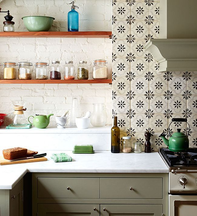 Patterned tiles and moss green cabinets in the kitchen