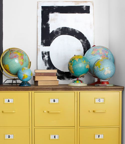Thrifted filing cabinet, painted yellow and topped with plywood.  Amazing DIY.  The wall art (5) is DIYed as well