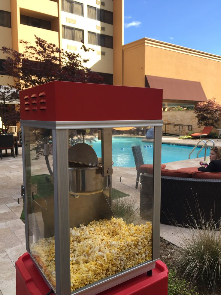 Staff appreciation party--- Popcorn machine rental out by the pool area.