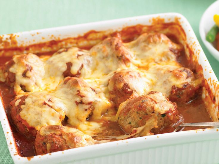 Meatballs are always a winner, but this recipe bakes them with a layer of melted cheese on top. So good!