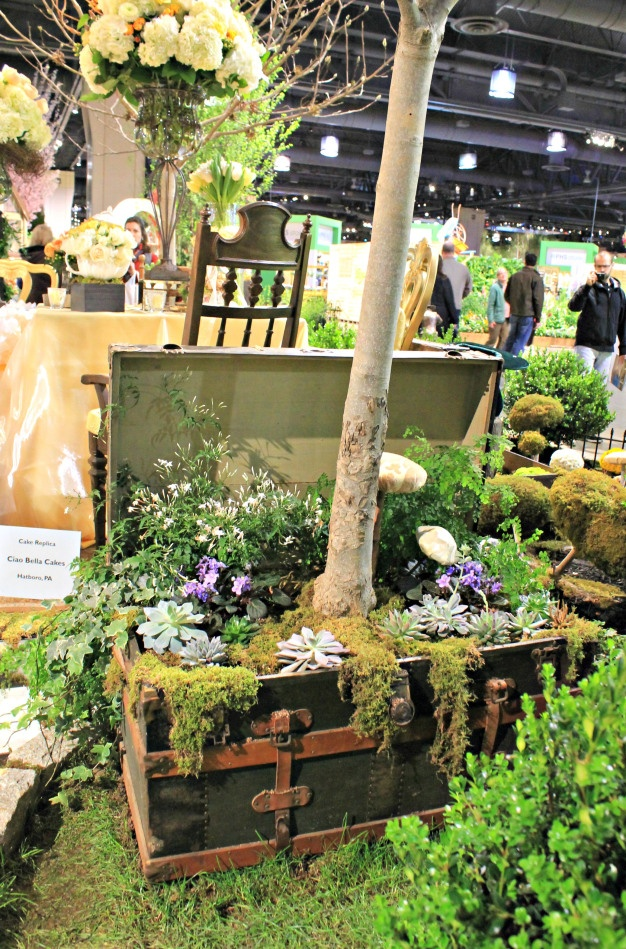 brilliant use of vintage trunks at the philadelphia flower show!  trunk planters
