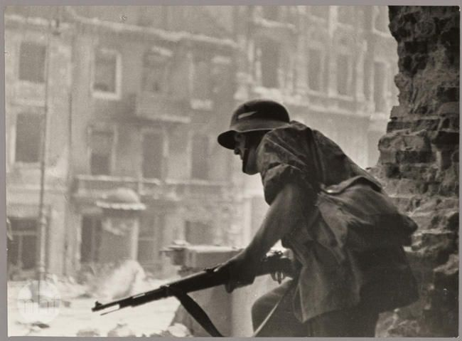 """""""Powstaniec"""" (Insurgent). Warsaw, 1944. Photo by Haneman Eugeniusz (1917 - 2014)."""