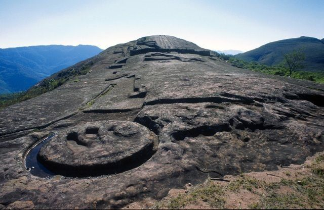 El Fuerte de Samaipata is a unique archaeological site in the mountains of central Bolivia. It features a stone hill carved with a wide variety of animal and geometric figures. It has been designated a World Heritage Site