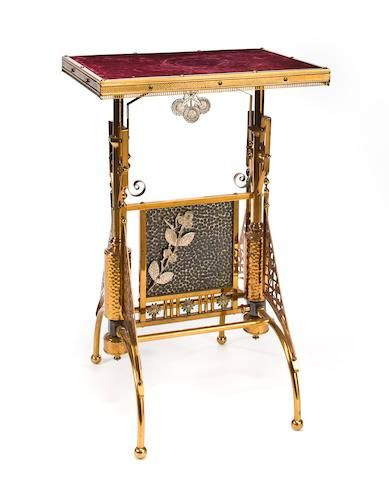 An American Aesthetic brass and silvered metal stand Attributed to Charles Parker Company, Meriden, Connecticut, circa 1880