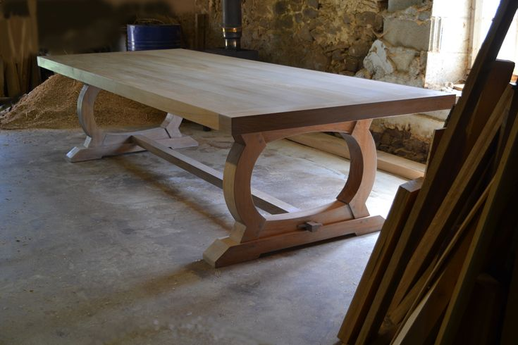 This dining table is the perfect place for family feasts. The beautiful curved of the base are joined with a traditional pegged stretcher. Handmade to order.