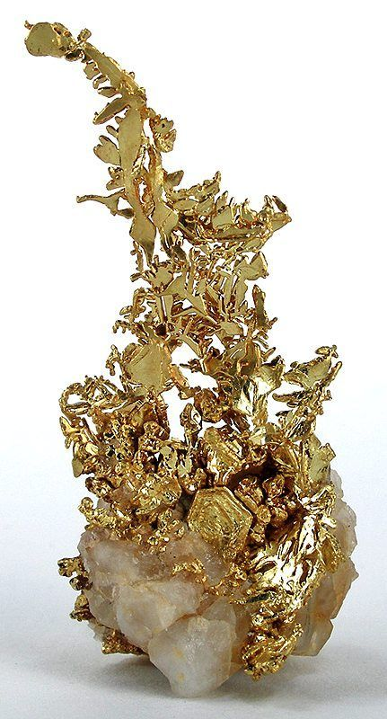 "This is a beautiful specimin of raw, pure gold. ""Legend states that Gold is a masculine stone ruled by the sun expressing it's projective qualities on other minerals and crystals, especially topaz, rubies, orange zircon and peridot…all whose power increases when set in Gold"""