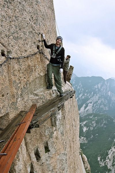 China's Mount Hua -The Plank Walk, the most famous, & dangerous, trek on Hua, joins the north & south peaks. A more benign, alternative trail has been opened but many continue to test their courage & luck by hugging the sheer rock. (image: Aaron D Feen/Flickr)