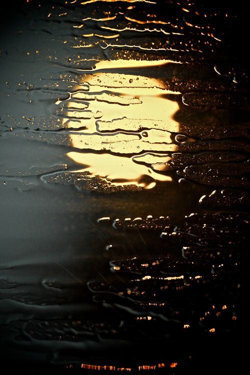 Moon reflection after the rain through glass