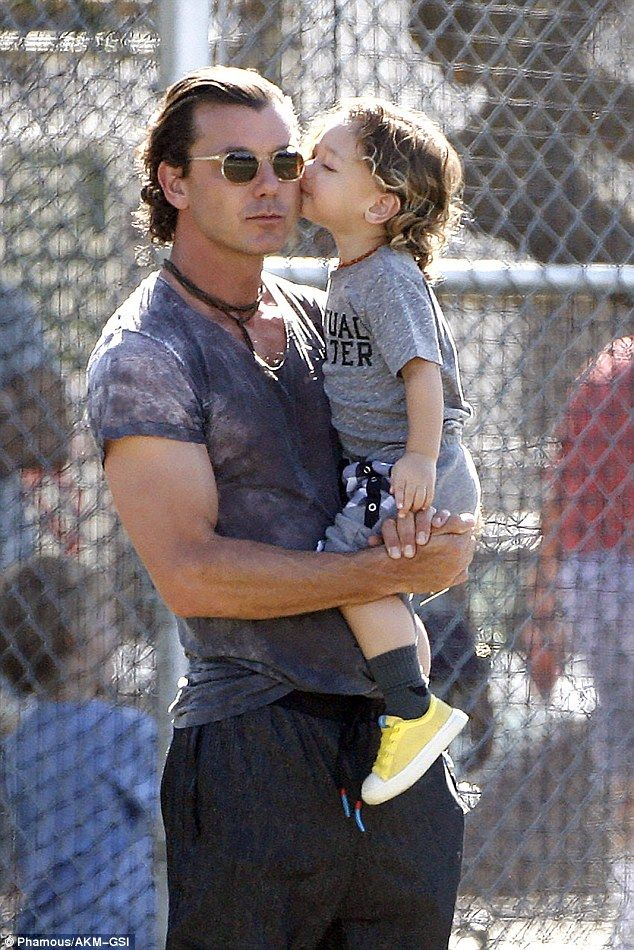 Sweet: Gavin Rossdale got a kiss from son Apollo as the pair watched seven-year-old son Zu...