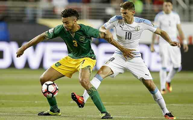 Uruguay 3 Jamaica 0 in 2016 in Santa Clara. Michael Hector shields the ball from Gaston Ramirez in Group C at Copa America.